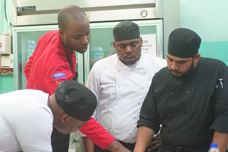 Members of the Trinidad & Tobago National Culinary Team 2017 preparing for practice dinner